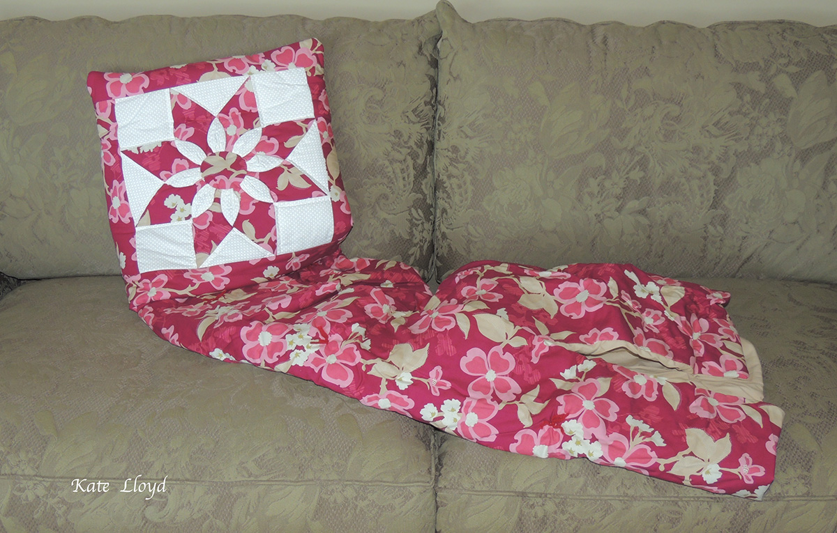 "A pillow that opens to be a 40"" X 60"" quilt!"