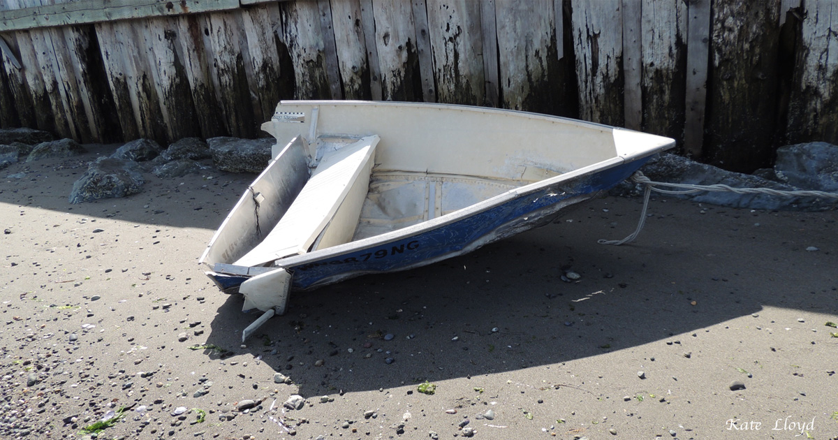 The high winds and waves slashed this boat in half. Many boats were lost; ours was safe onshore.