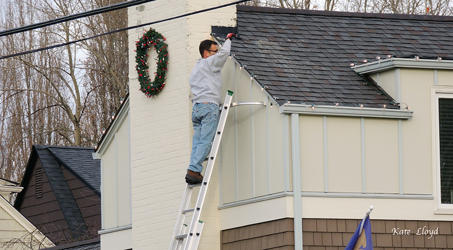 I hope this man is a professional and not a neighbor's husband stringing these lights!