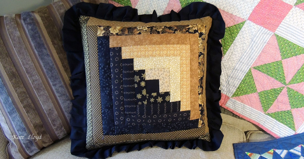 Enter to win this Amish made log-cabin pattern pillow.