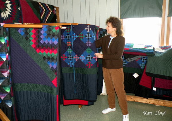 Kate Lloyd admiring Emma Stoltzfus' quilts in Lancaster, PA.