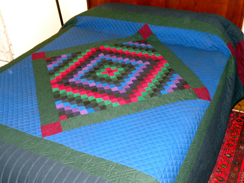 What a lovely Sunshine Diamond Amish quilt!