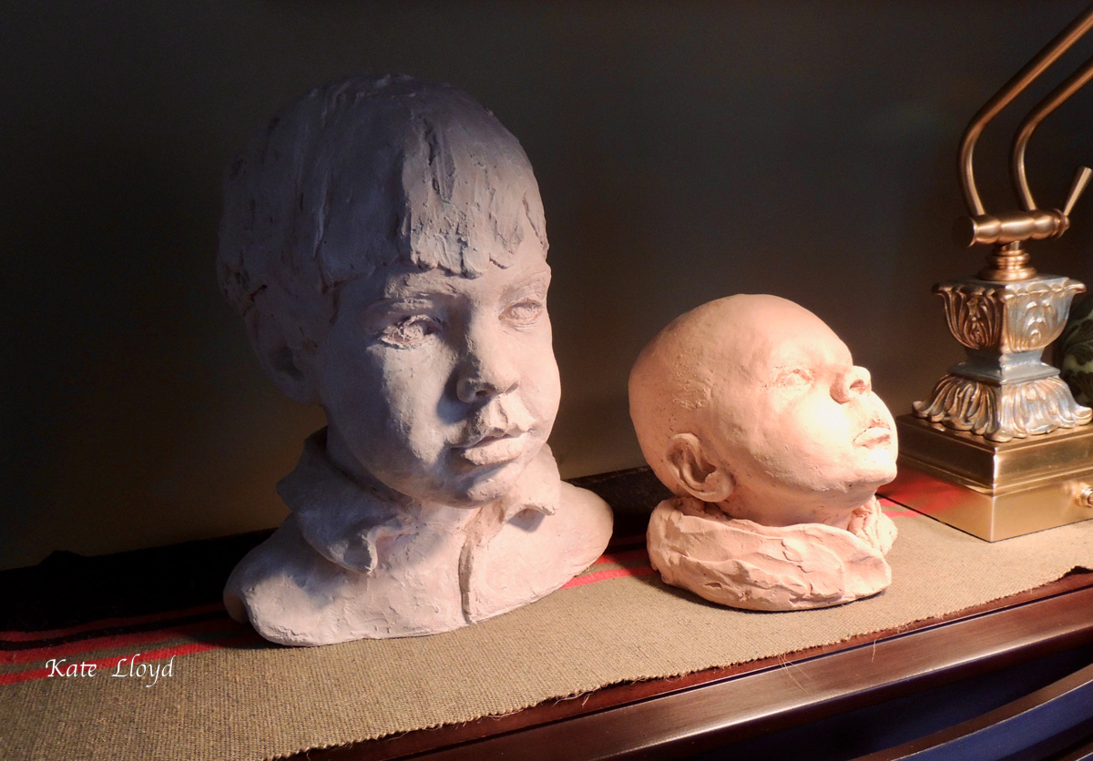Our sons' clay portraits reside atop our piano. Mom cast most in bronze.
