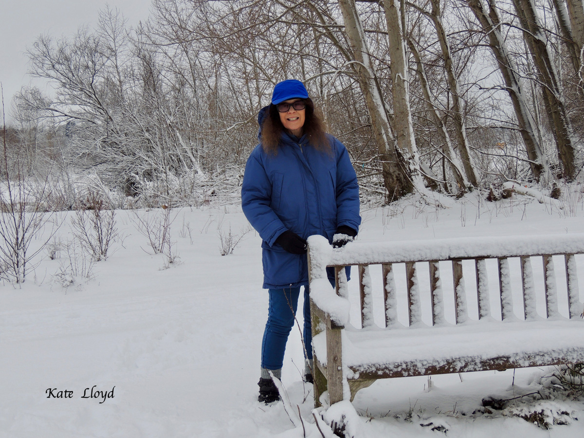 Pausing to catch my breath during a brisk walk in the pristine snow.