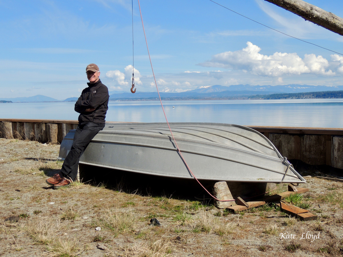 My husband with our boat. Perfect for pulling up crab-pots!