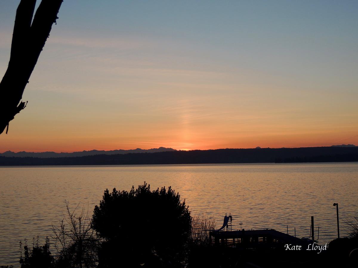 Sunrise taken across Lake Washington toward the Cascade Mountains.
